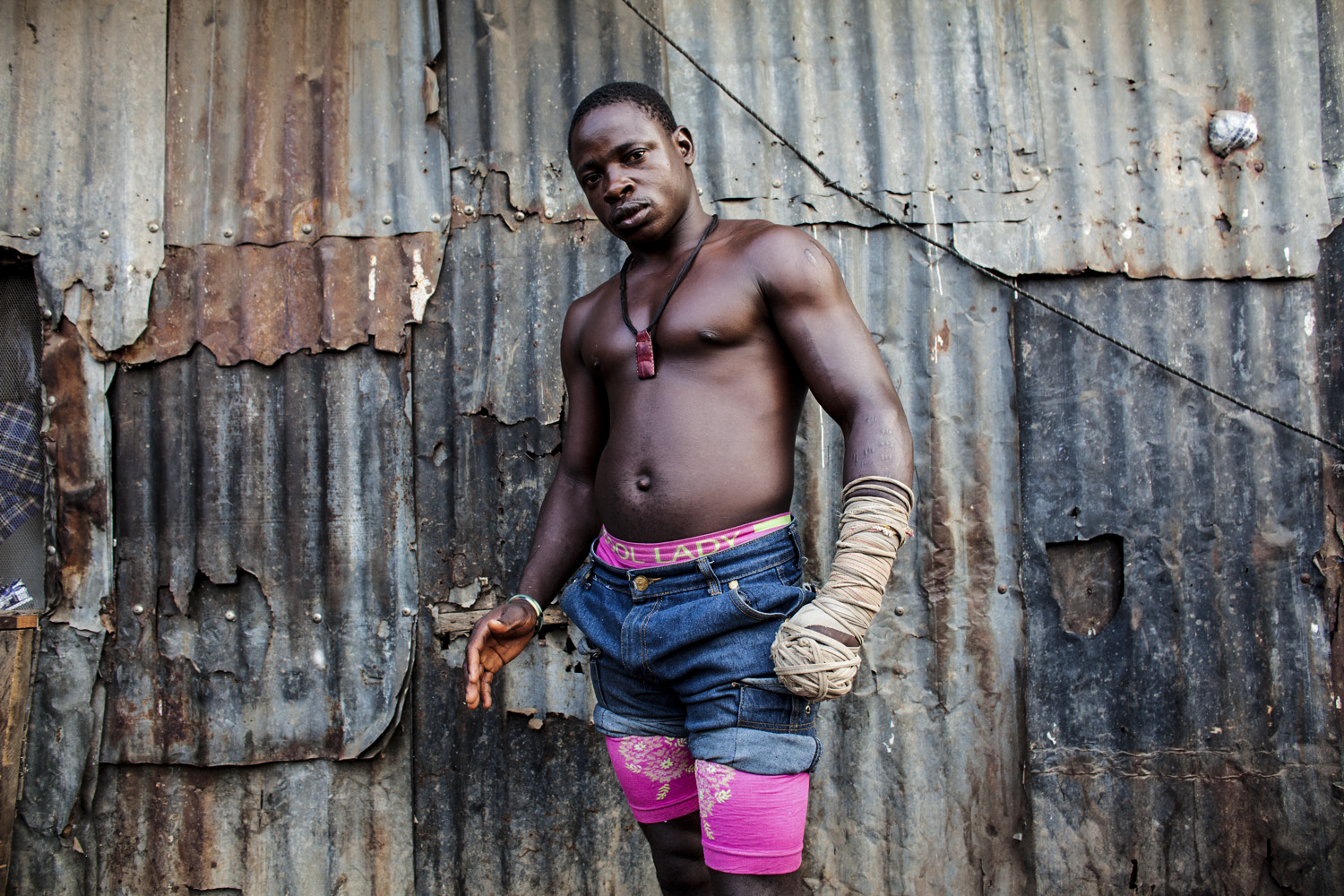 1. Hassan Abu Trassan, 22, is from Niamey in Niger. He began boxing to seek fame and fortune. / 2. Dambe boxer 'Shago' Rikishi, 25, poses for a portrait in Lagos.