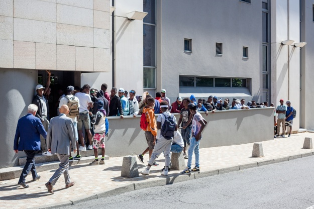 1. Migrants get some rest after their long journey from Italy to the emergency shelter of Briançon. / 2. Unaccompanied minors line up at the Regional Council of Hautes-Alpes in the city of Gap for public assistance.