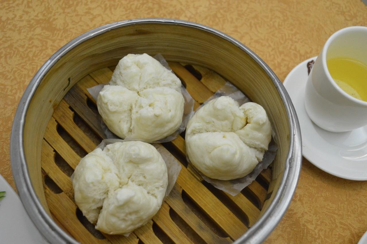 A basket of freshly steamed char siu bao—barbecued pork dumplings—at Tang Dynasty.