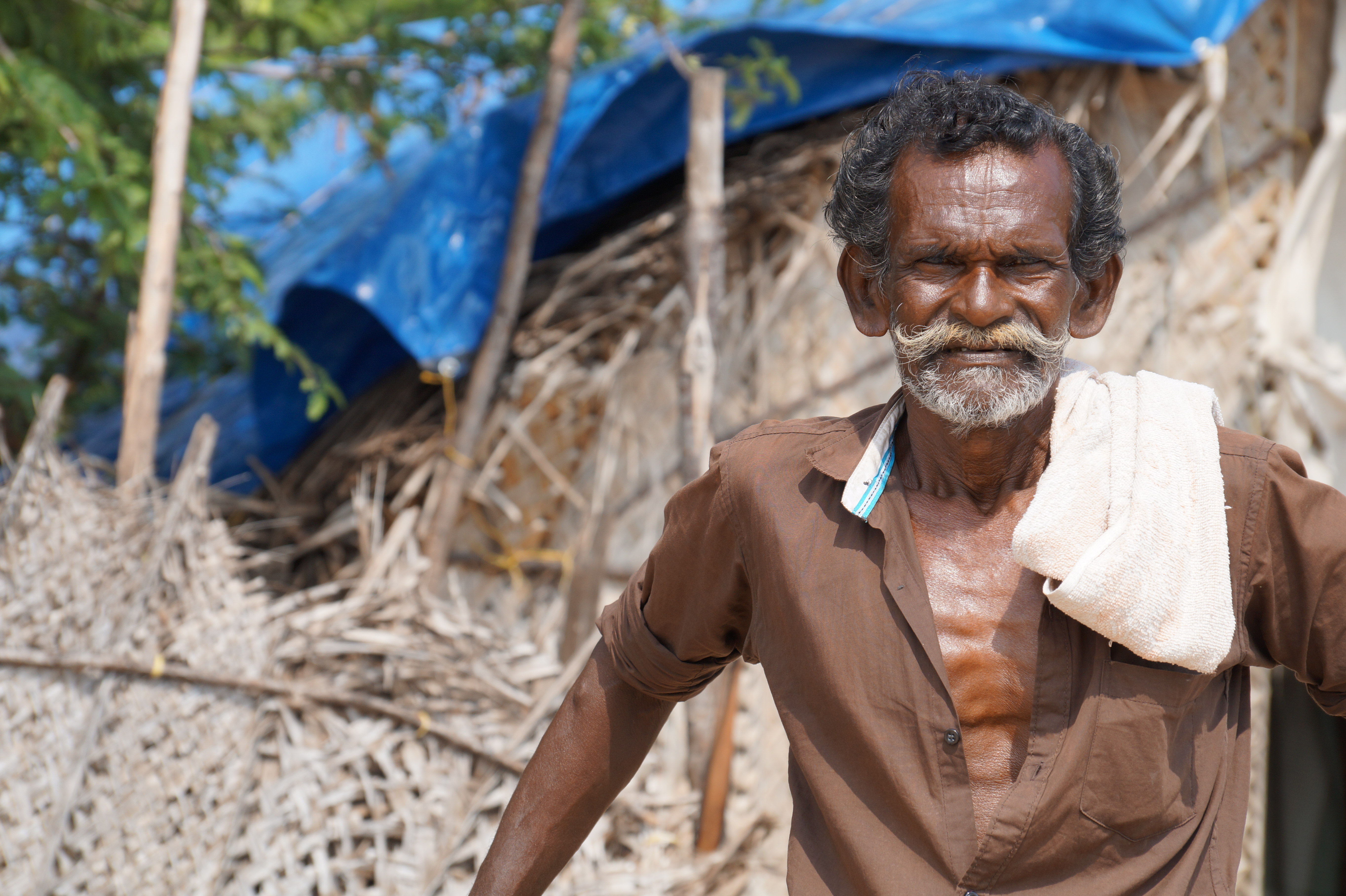 1. Anthony was born across the Strait in Sri Lanka but has lived in Rameswaram since 1974. Several days a week, he'll leave the harbor at 1 p.m. in his country boat, go nine miles out to sea, stopping just short of the international boundary, and return the following morning. / 2. The office of a seafood distributor just behind the jetty in Rameswaram.