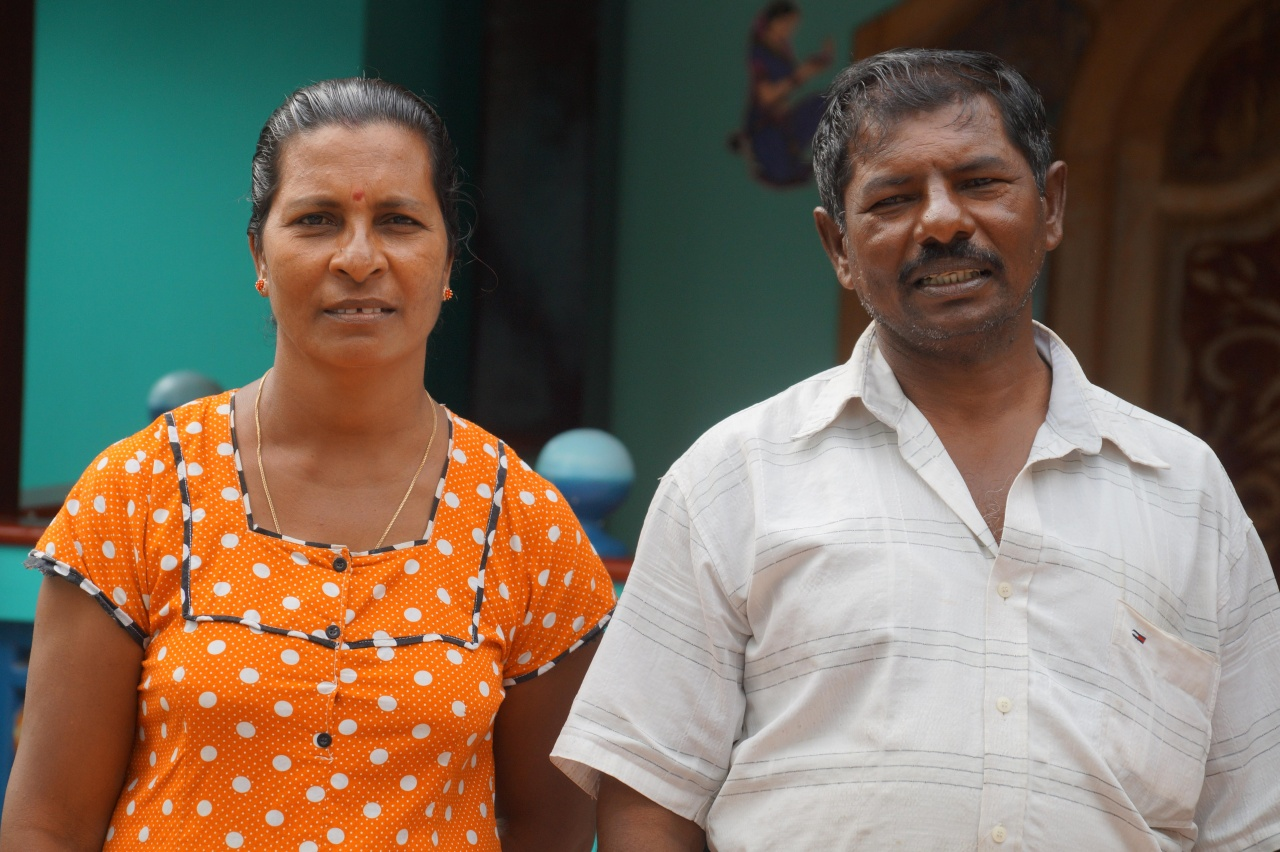 Stephen Croos and his wife Mariyarani in front of their new home in Pesalai.