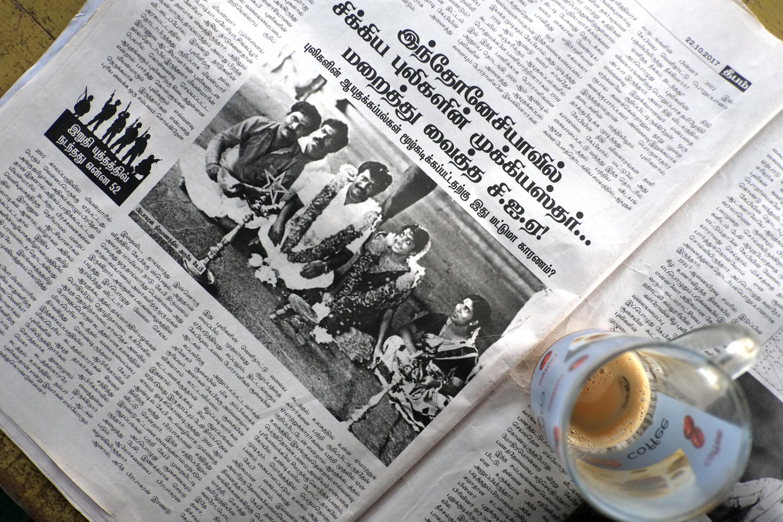 A newspaper shows Prabhakaran at his wedding.