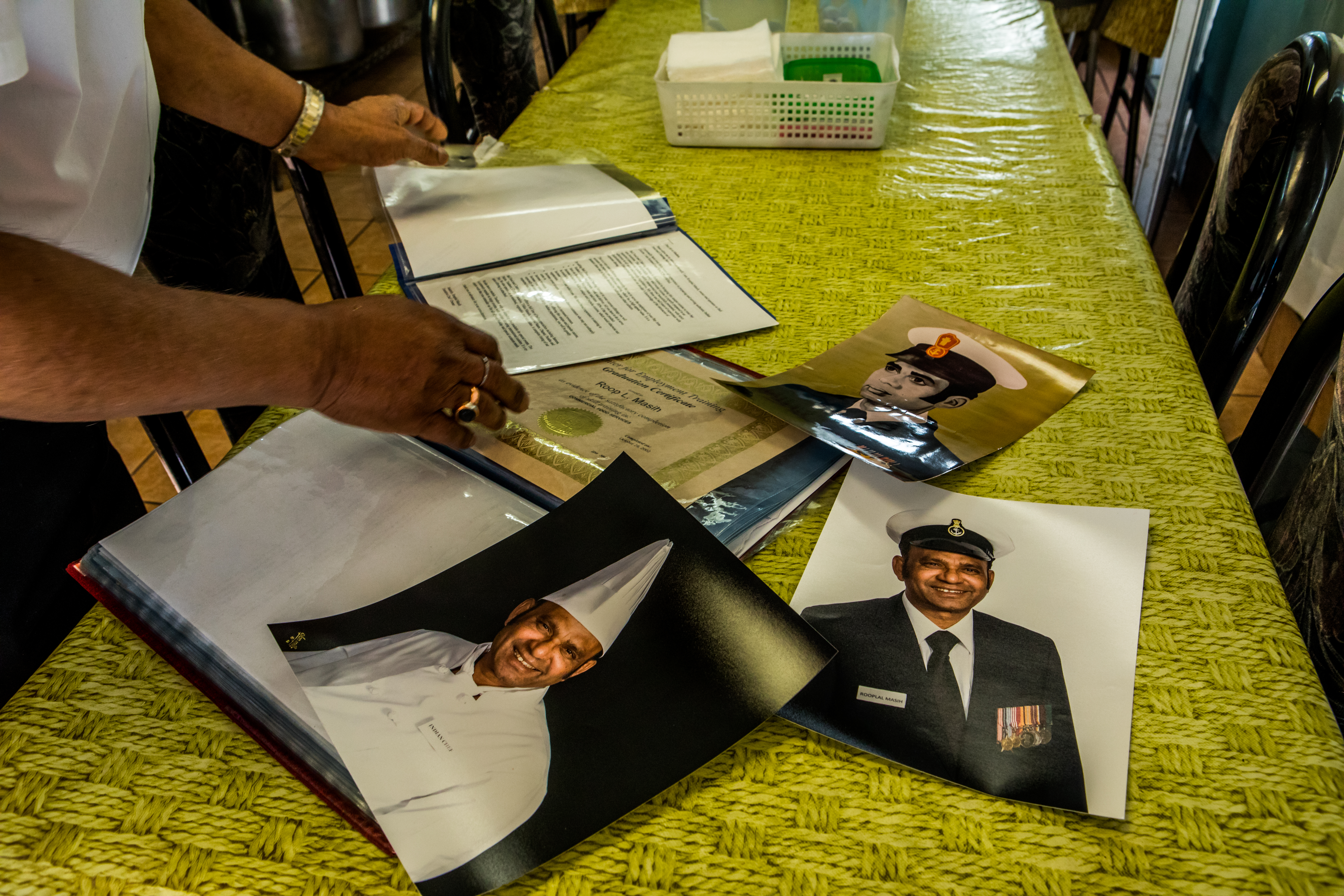 1. Rooplal Masih shows off portraits from his past. / 2. The couple in their restaurant.