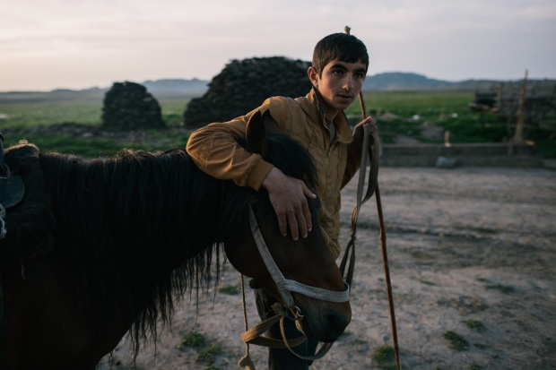 A young Azerbaijani shepherd and his horse.