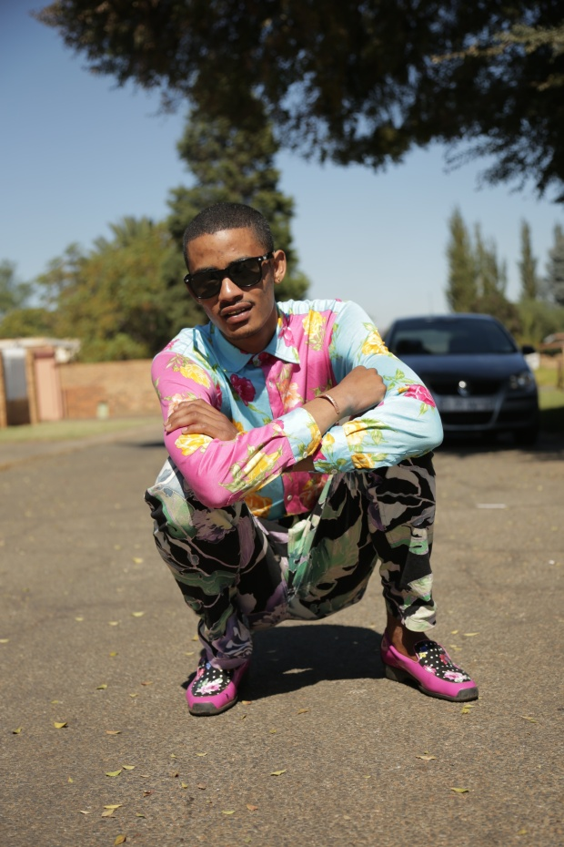 Tolouse poses outside of his mother's home in El Dorado park in a Rossi Moda shirt costing 2,300 rand.