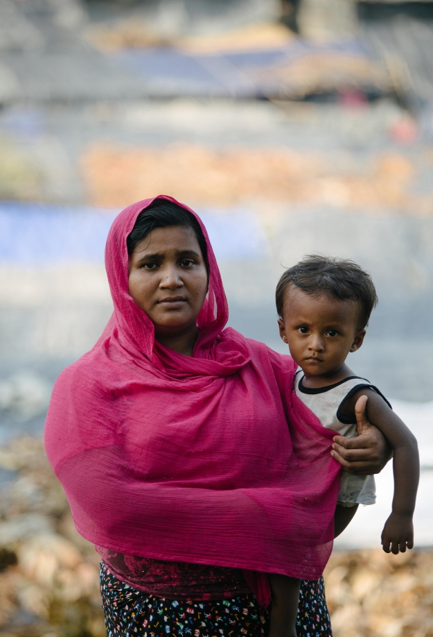 """I am Sanwara Begum from Boli Bazar, Burma. I have two children and a husband and fled from the Mogh (Buddhist militias) who came to our villages and started shooting."""