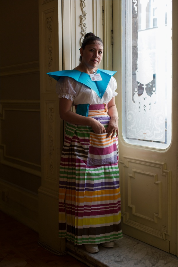 An employee in traditional dress at Sanborn's