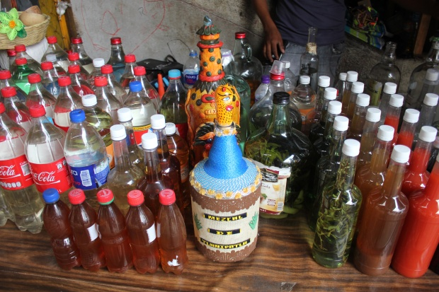 Mezcales and mezcal infusions at the Central Market in Chilpancingo, Guerrero. (Photo by Bill Esparza)