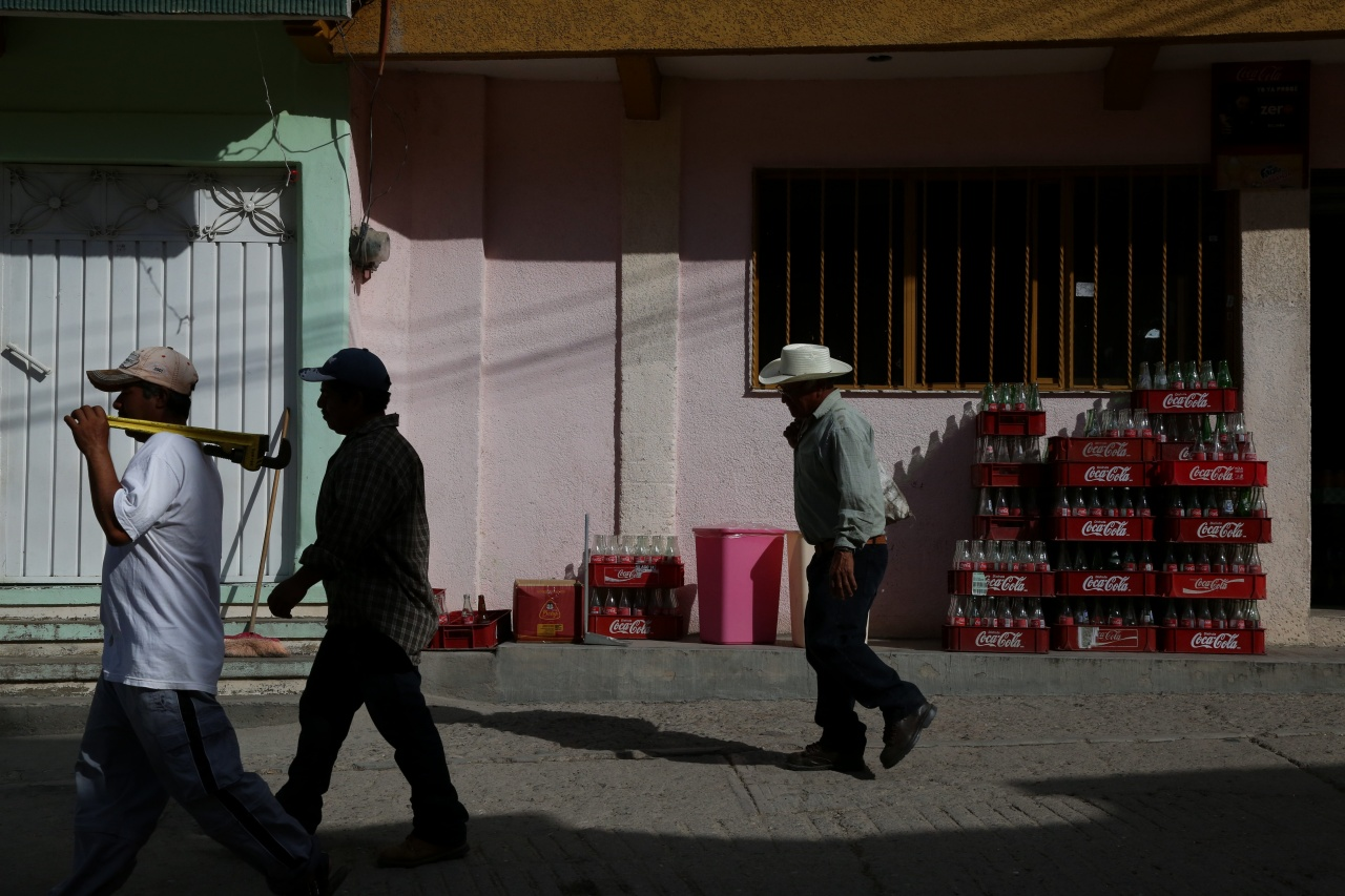 Day laborers walk to work in San Juan del Rio, Oaxaca, Mexico, a primarily subsistence farming village.