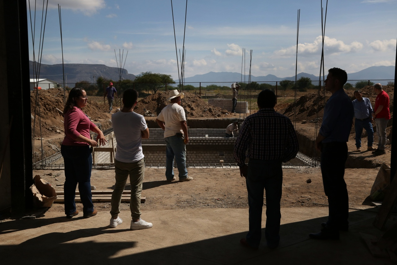 A team from Mezcal Amores tours the construction of a new facility for research and production of their Verde line in Tlacolula, Oaxaca, Mexico,