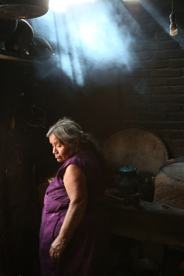 Photo 1: Fortunate Angeles rests at his palenque in San Juan del Rio, Oaxaca, Mexico. After years in America, he is happy to come home to a more tranquil life, particularly now that he' s partnered with Mezcal Amores. Photo 2: Teresa Raymundo cooks stew at her home in San Juan del Rio, Oaxaca, Mexico.