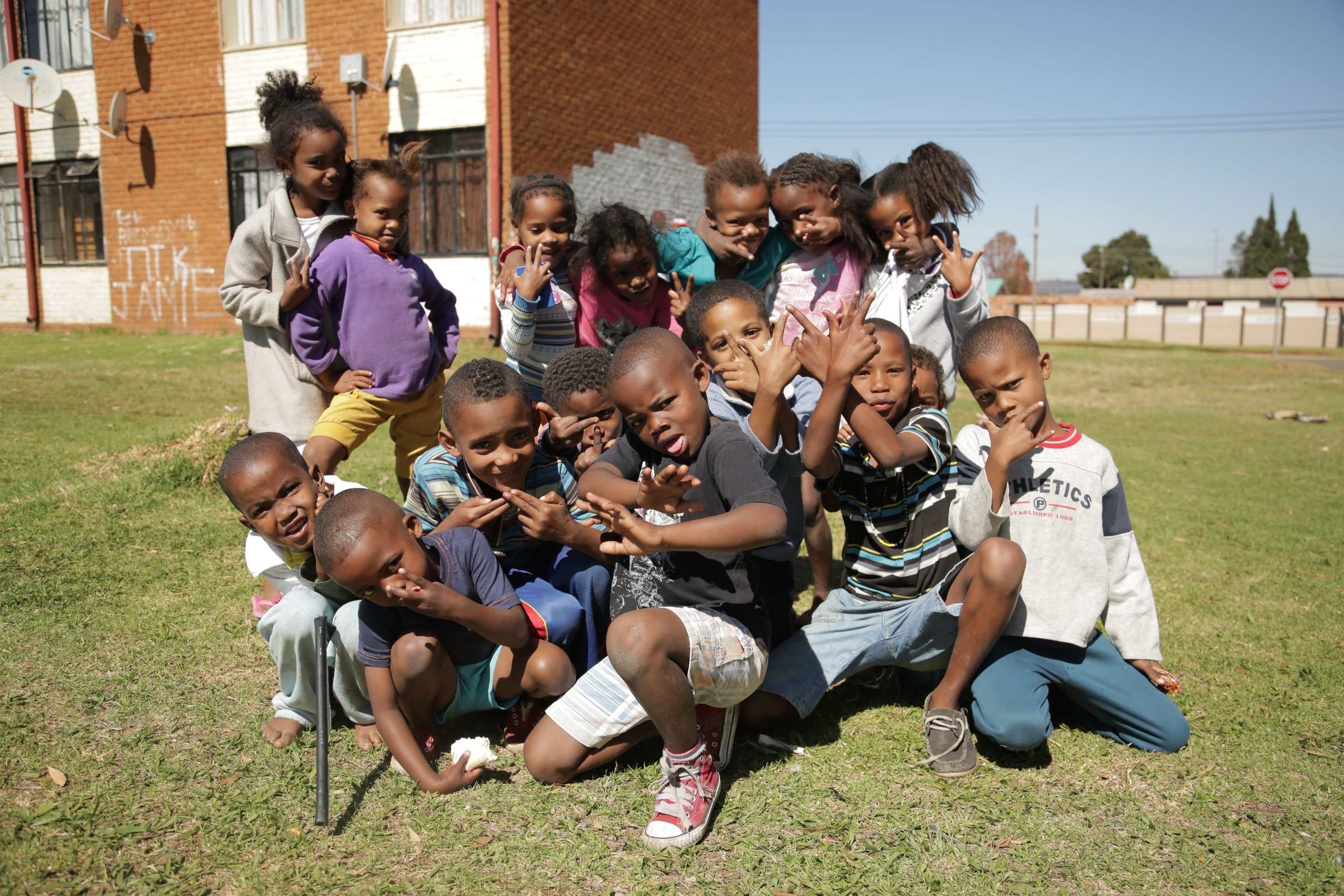 "1. The skhothanes are proud to show off the media coverage their lifestyle has attracted. Lead member Tshepo remarks: ""If I hadn't come here [to Soweto], I wouldn't be in magazines."" / 2. The children of El Dorado Park are quick to mimic The Commandos posing and ""skhoting."""