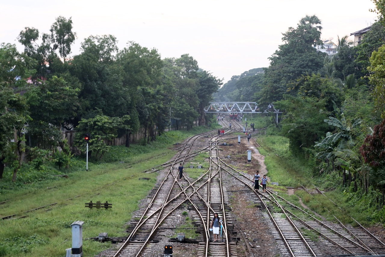 Yangon residents often use the train tracks to cut through the traffic chaos of Myanmar's biggest city to reach their homes.