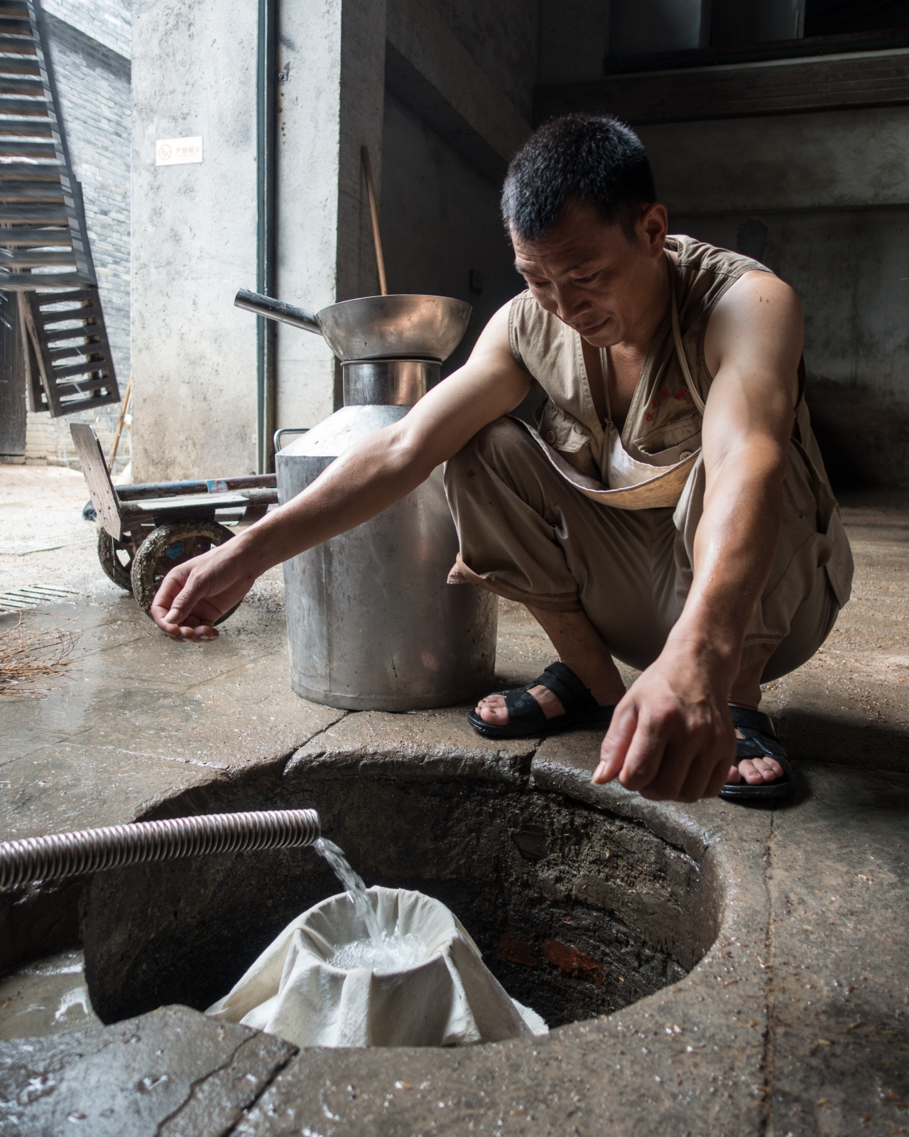 Raw distilled spirits are collected at the Shui Jing Fang Museum.