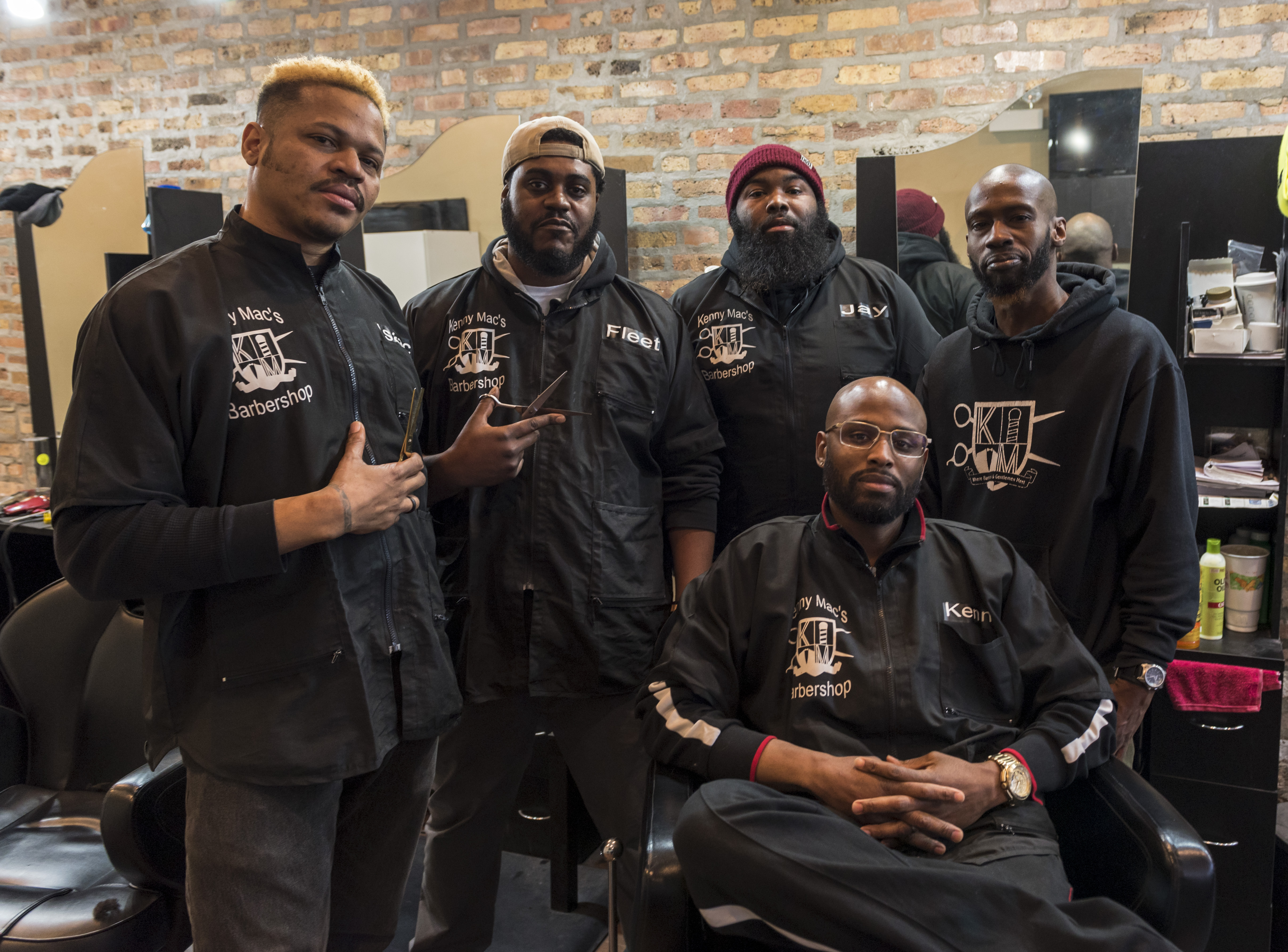 From left to right: Isaac Haygood, Fleetwood Wynton, Jay Johnson, Sean Gee, and seated in the chair is Kenny Mac, the owner of the shop.