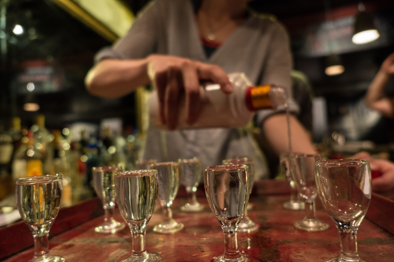 A server pours a Baijiu tasting at Capital Spirits.