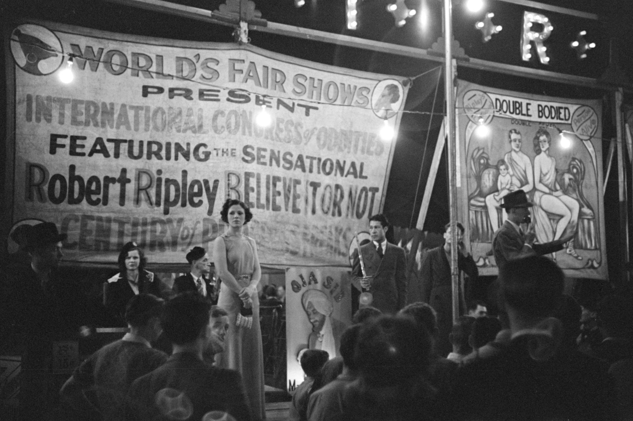 """The yearly """"Believe it or Not"""" carnival entertains a crowd in Granville, September, 1938. Photo by Marion Post Wolcott."""