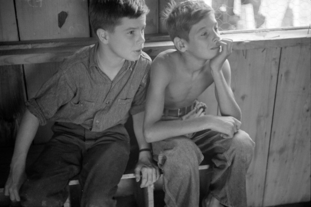 Photo 1: Two boys watch a puppet show in Red House, 1937. Photo 2: A band rehearses outdoors in Red House, 1937. Photos by Ben Shahn.