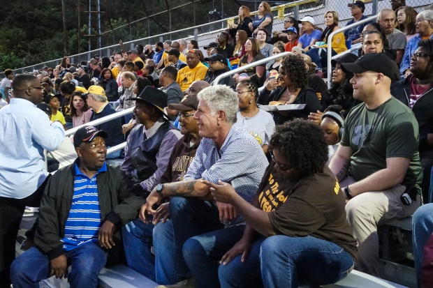 Tony takes in the Mt. View homecoming game with locals Garnet Edwards, Garnet Edwards, JR, and Monica Barner.