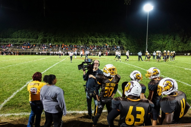 Photo 1: Camera Operator Josh Flannigan captures the Mt. View football team prepping for practice. Photo 2: Jerry Risius captures the action from on the field at Mt. View's homecoming game.
