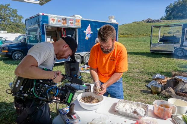 Camera operator Josh Flannigan films turtle meat cakes being prepped for the griddle at King Knob Motorsports Park.