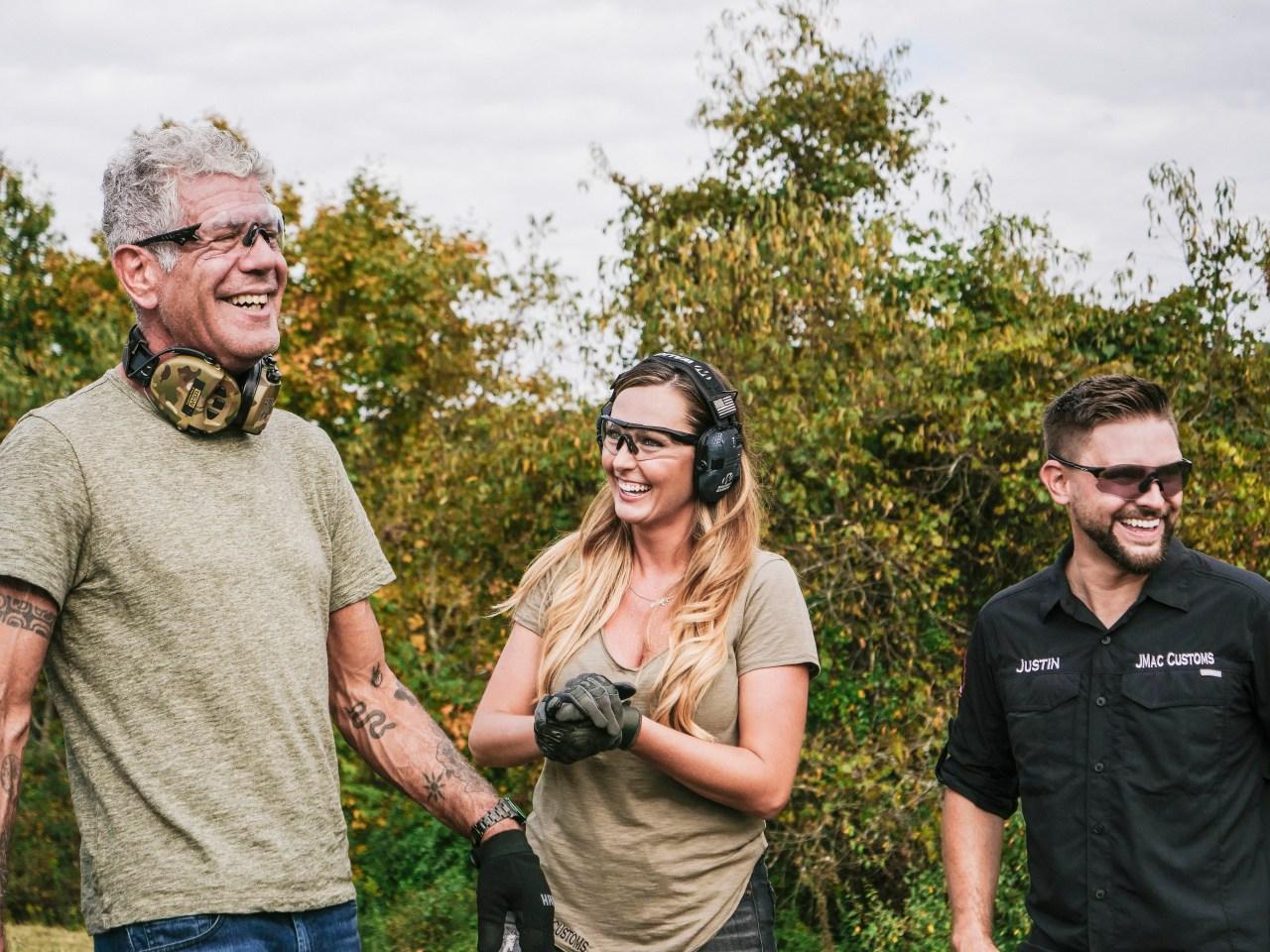Bourdain shooting guns in West Virginia. Photo by David Scott Holloway.