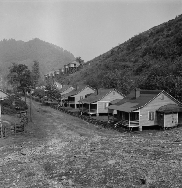 An unemployed coal miner in Scotts Run, September 1938. Abandoned homes in Twin Branch, September, 1938. They were originally built for workers at a mine owned by Ford, but when the workers began to form a union, Ford shut down the mine. The workers, which Wolcott estimated at 1000 men, were forced from the homes. Photos by Marion Post Wolcott.