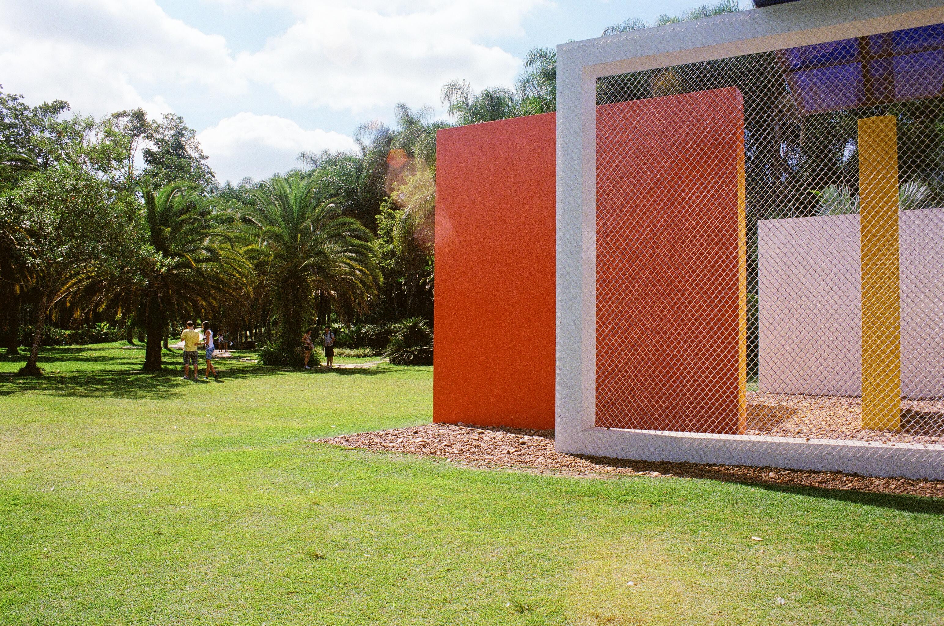 """Beside Hélio Oiticica's """"Invençaõ da cor, Penetrável Magic Square No. 5 – De Luxe"""" (The Invention of the Colour Penetrável Magic Square No. 5 – Deluxe)."""