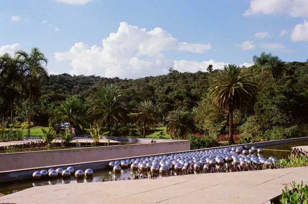 """Photo 1: """"Beam Drop Inhotim,"""" by American Chris Burden, was created by having a crane release steel beams into a large pad of wet cement. Photo 2: View from the rooftop of the Burle Marx Center for Education and Culture, site of Yayoi Kusama's """"Narcissus Garden."""""""