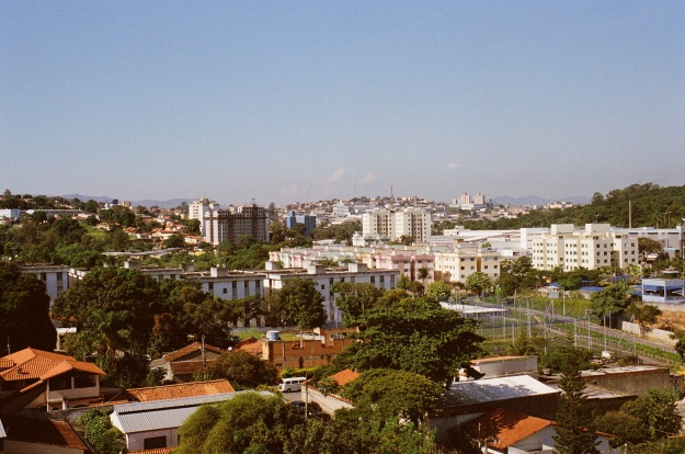 Photo 1: Pampulha neighbourhood, Belo Horizonte. Photo 2: Swans glide by on one of Inhotim's tinted ponds. A benign colorant has been added to mask the reddish hue of the area's iron-rich water.