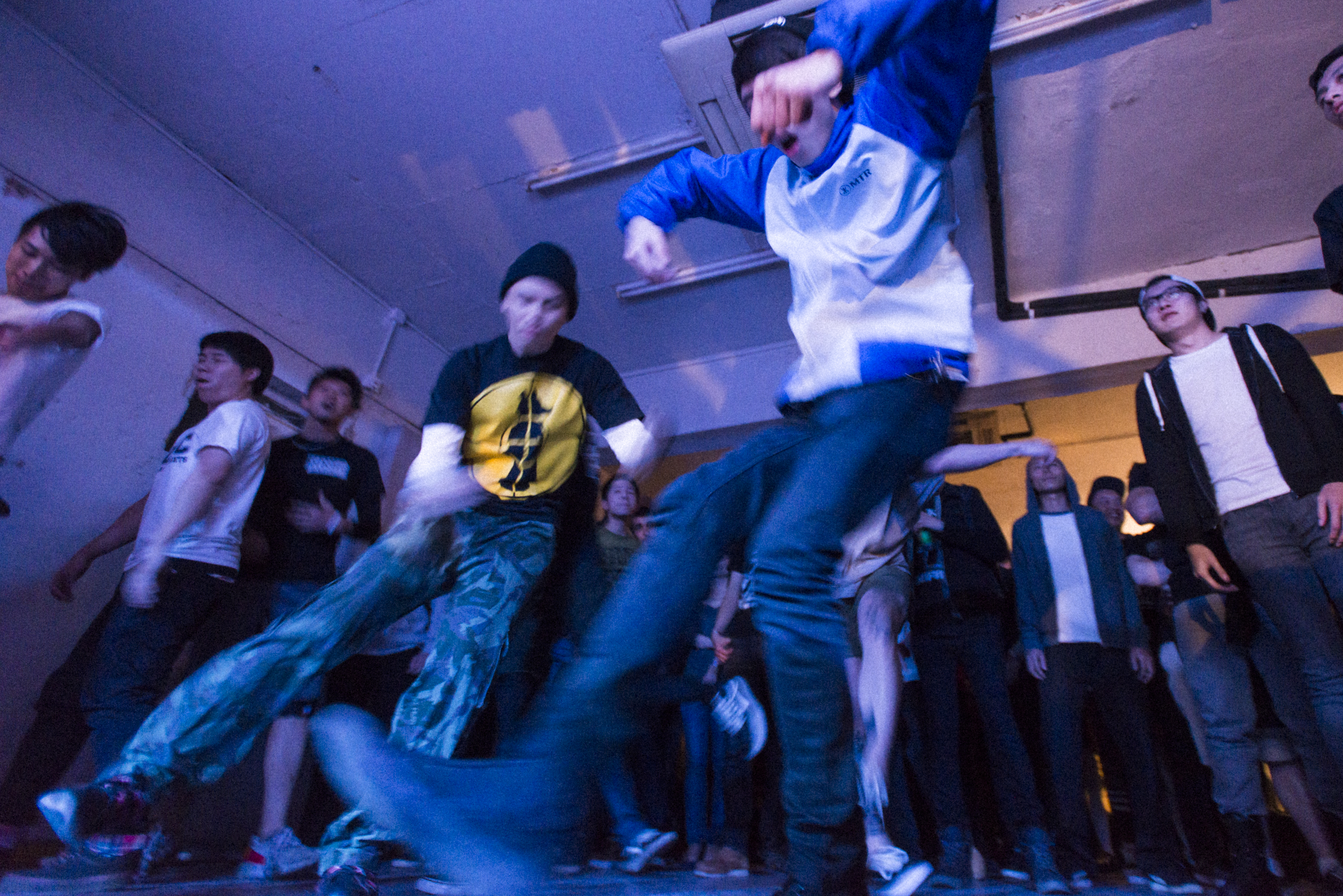 Fans two-step dance at a show.
