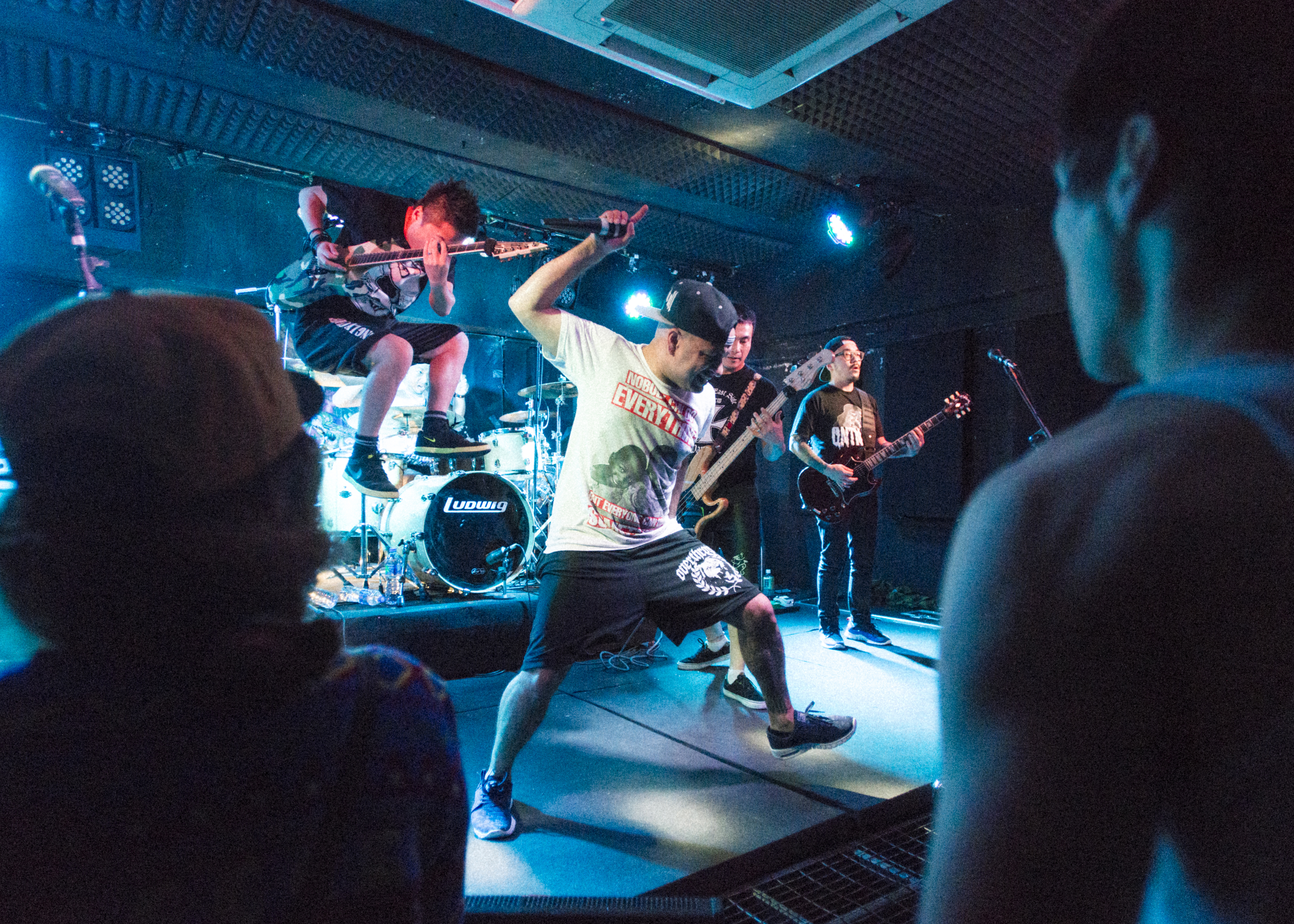 1. Young fans enjoy the music during a show. 2. King Ly Chee on stage during a show. The band has been a major player in the local Hong Kong music scene for more than 15 years.