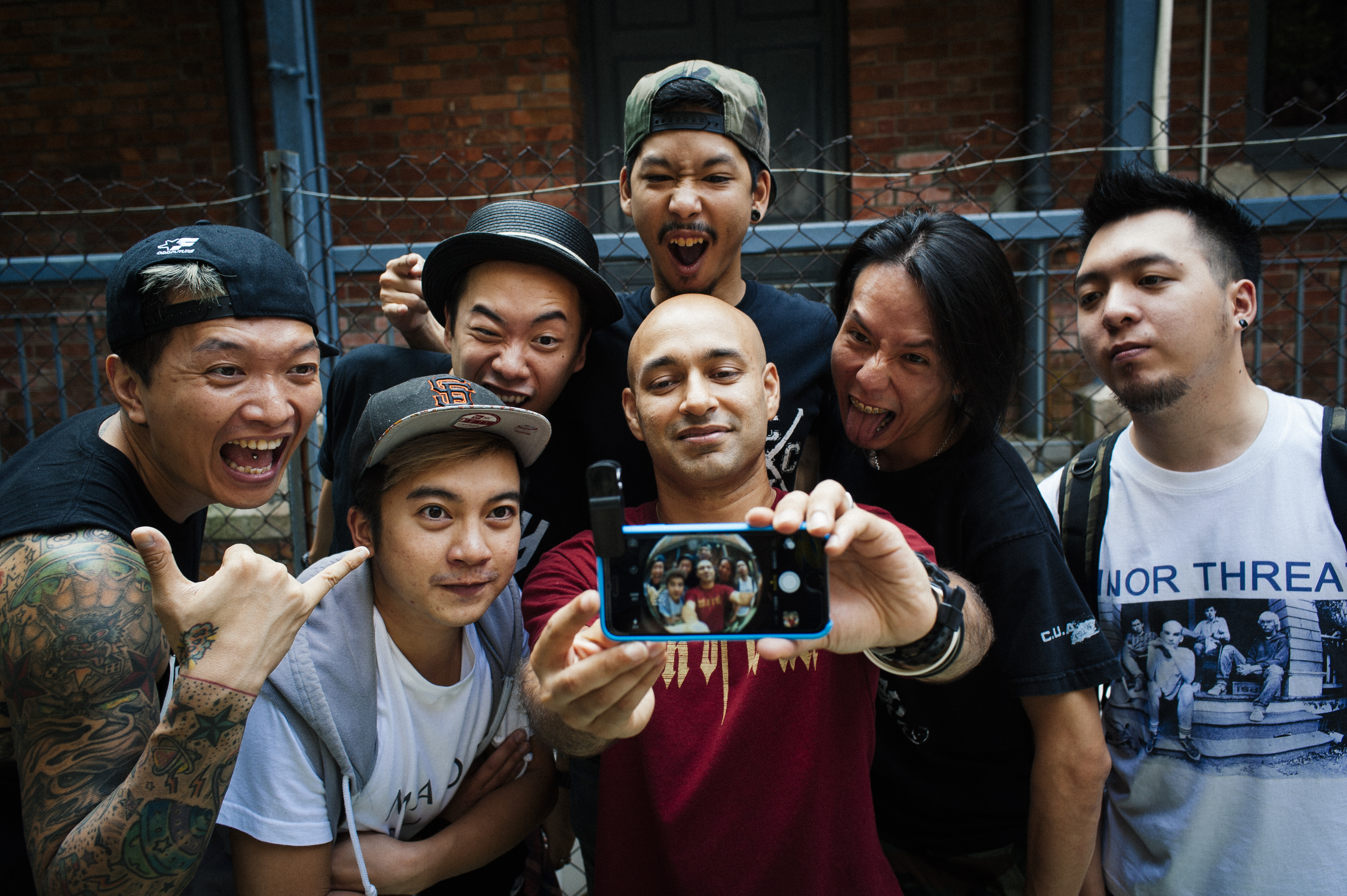 Past and current members of King Ly Chee pose for a selfie.