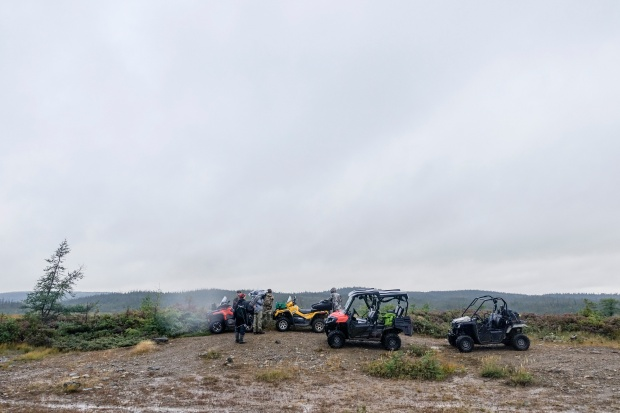 The team with their ATVs while hunting.