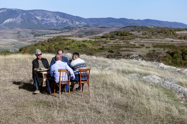 Tony and the men sitting on a hillside in Nagorno-Karabakh.