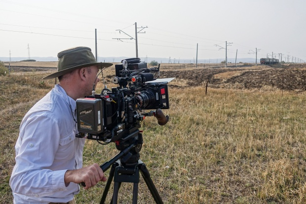 Director of Photography Zach Zamboni films a train in the countryside of Armenia.