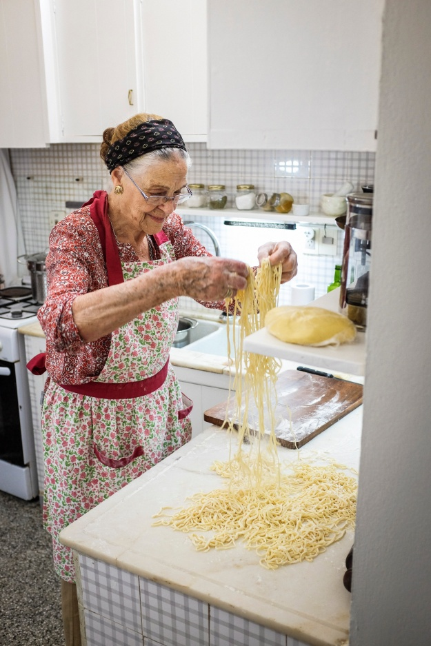 Chef Nacho and his grandmother Ercilia, making tuco with fresh tallarin.