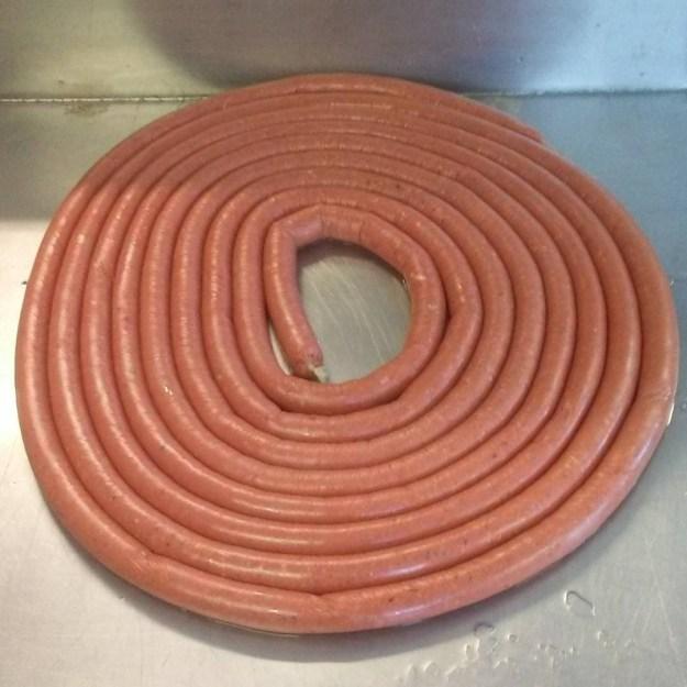 Making sausage at the shop in Renews.