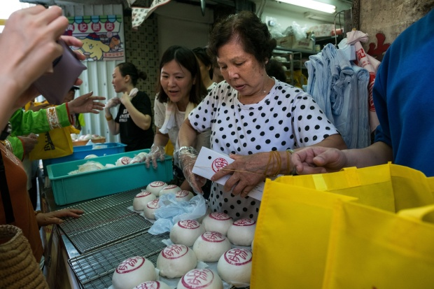 Customers buy traditional buns at Kwok Kam Kee bakery.
