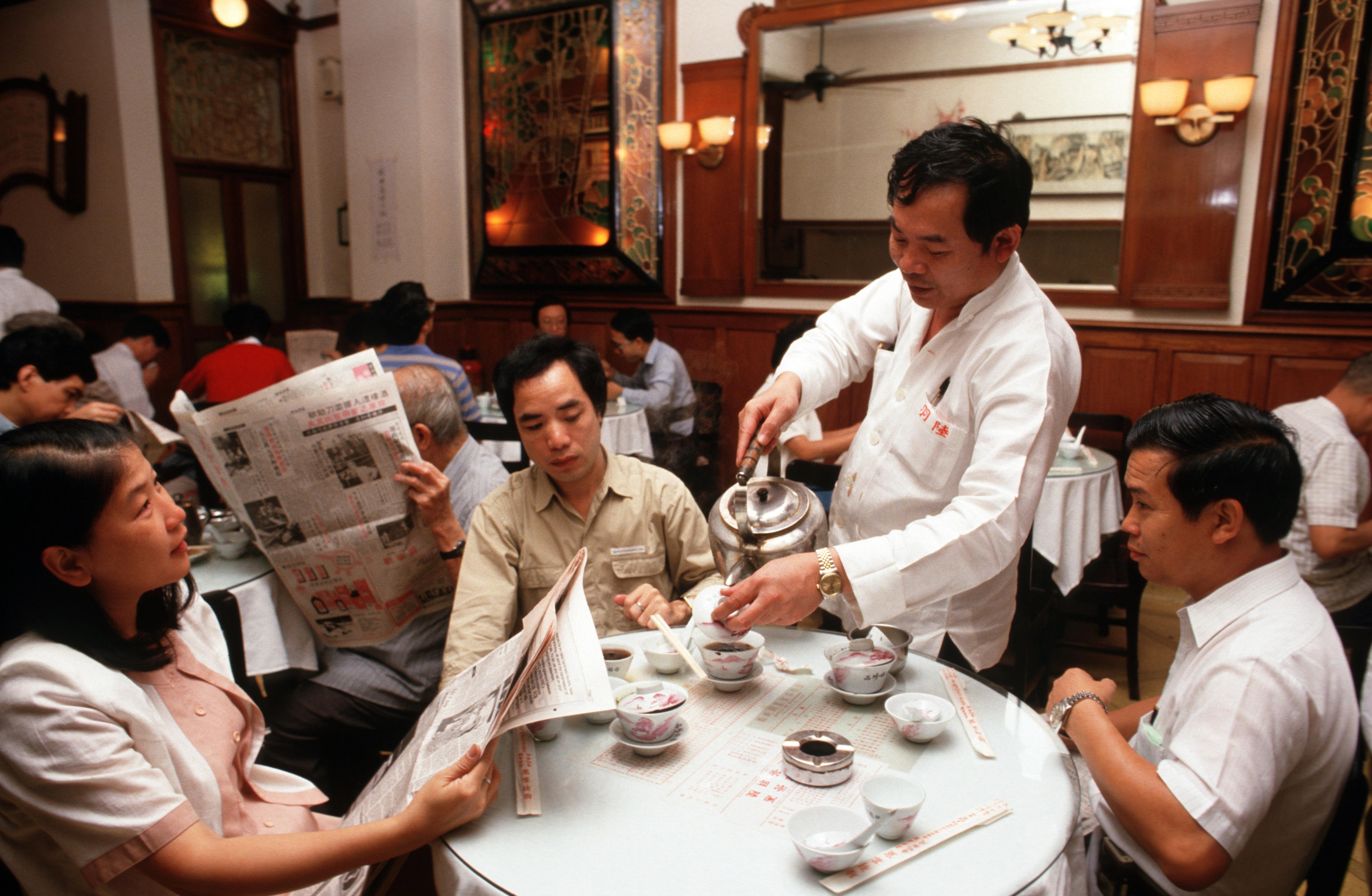 A waiter serves tea at Lukyu Tea House, Hong Kong. Photo by Peter Charlesworth/LightRocket via Getty Images.