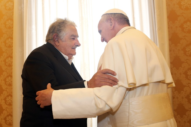 Pope Francis receives President of Uruguay Jose Mujica at his private library in Vatican City, Vatican. By Vatican Pool via Getty Images.