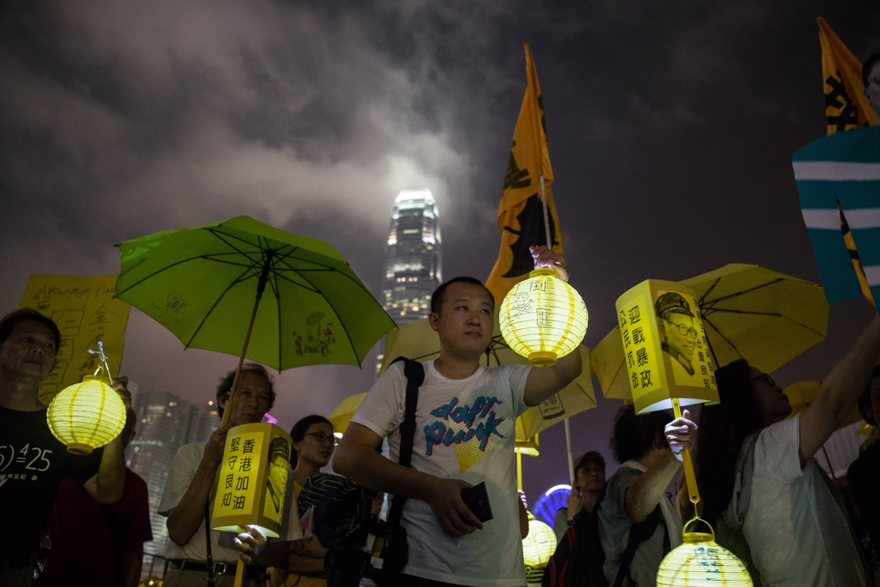 Activists march ahead of the anniversary of the Occupy Central protests. Photo by Anthony Wallace/AFP via Getty Images.