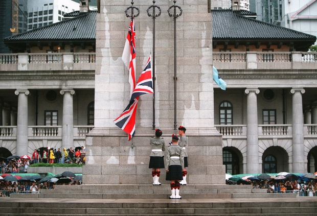 Soldiers lower the British flag prior to the return of Hong Kong to Chinese rule. Photo by Stephen Shaver/AFP via Getty Images.