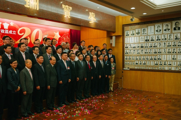 Hong Kong Chiu Chow Chamber of Commerce members celebrate the 20th anniversary of the handover. Photo by Billy H.C. Kwok via Getty Images.