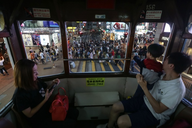 Passengers in a tram in Hong Kong. Photo by Vivek Prakash/AFP/Getty Images.