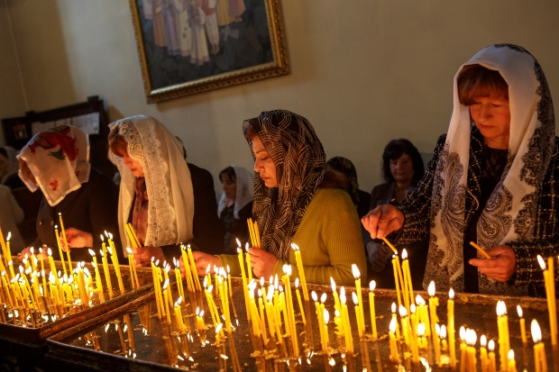 Worshipers pray and light candles at the Etchmiadzin Cathedral.