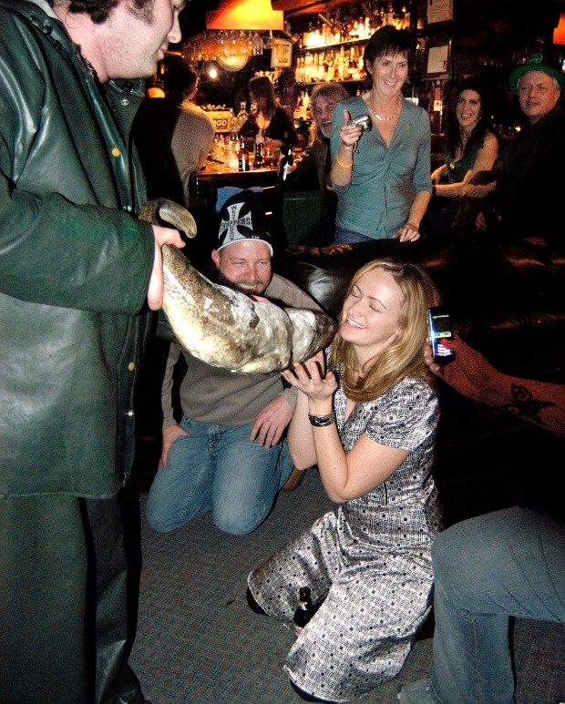 """Visitors get """"screeched in"""" at a bar on George Street in downtown St John's. Photo by Greg Locke."""