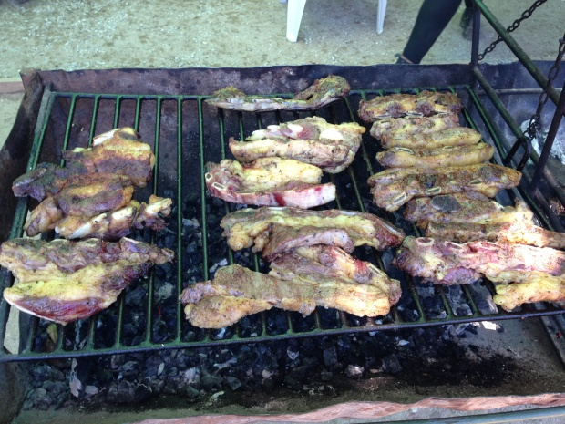 Uruguay's favorite cut of meat, asado de tira, grilling during a raid.