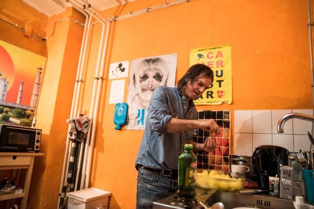 Anton Newcombe preparing his feast. Photo 1 by David Scott Holloway. Photo 2 by Josh Ferrell.