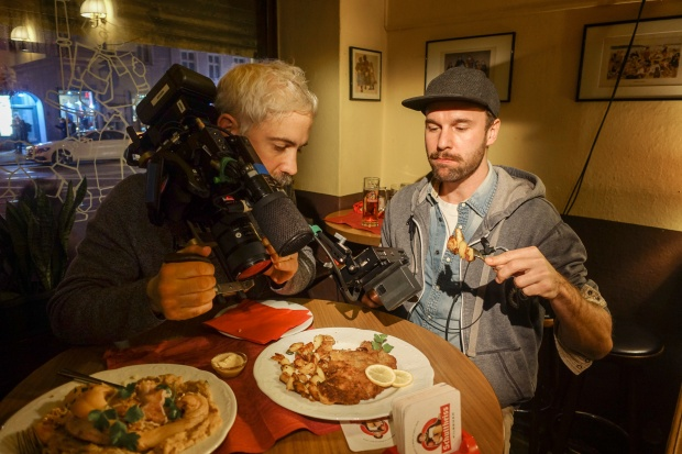Jeremy Leach films local crew member Dominik with schnitzel at Zum Schusterjungen. Photo by Josh Ferrell.